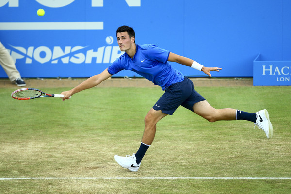Bernard Tomic lunges for a forehand during his semifinal loss. Photo: Jordan Mansfield/Getty Images