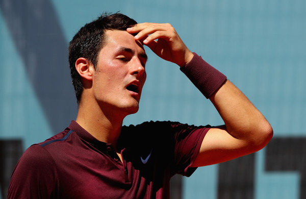 Bernard Tomic shows some dejection during his first round loss in Madrid. Photo: Clive Brunskill/Getty Images