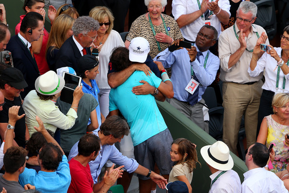 Toni and Rafael Nadal (in blue) embrace after Rafael's 2014 French Open title. Photo: Clive Brunskill/Getty Images