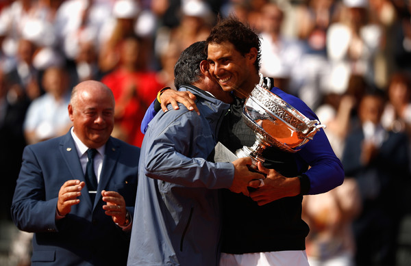 Uncle and nephew embrace after Nadal recorded his 10th success at Roland Garros earlier this year (Photo: Adam Pretty/Getty Images Europe)