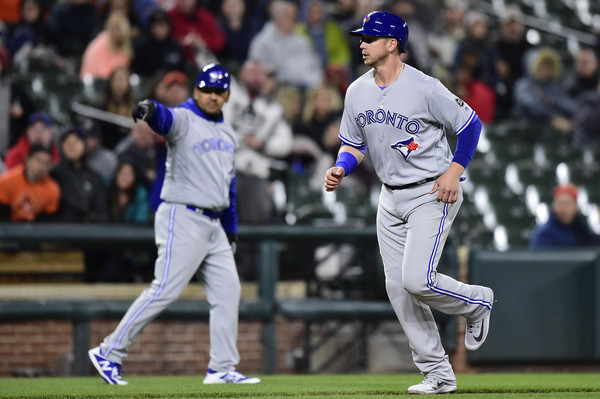Justin Smoak being waved home after a throwing error by right fielder Anthony Santander saw the ball go into one of the dugouts. This would be Toronto's first run of the night. | Photo: Patrick McDermott/Getty Images