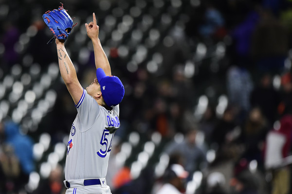 Roberto Osuna celebrates after becoming the youngest closer in Major League history to record 100 saves at 23 years and 62 days old. | Photo: Patrick McDermott/Getty Images