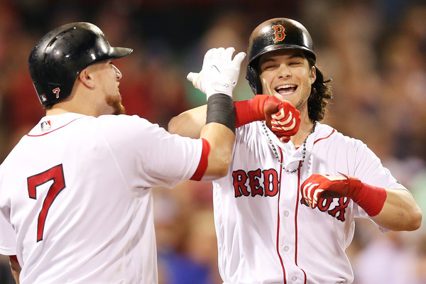 Andrew Benintendi celebrates with Christian Vazquez after hitting a solo home run in the eighth to make it a one-run game against the Blue Jays. | Photo: Adam Glanzman/Getty Images