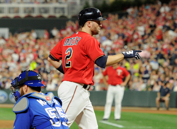 Brian Dozier returns home after belting a solo homer in the fourth to give the Twins a 3-1 lead. | Photo: Hannah Foslien/Getty Images