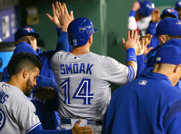 Justin Smoak celebrates after scoring in the third inning. | Photo: Rick Yeatts/Getty Images