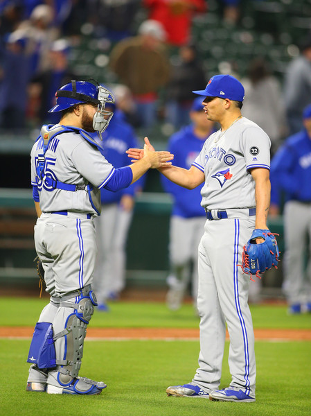 Roberto Osuna (R) and Russell Martin celebrate after closing out the win. | Photo: Rick Yeatts/Getty Images