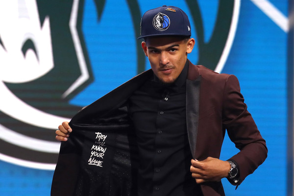 Trae Young reacts after being drafted fifth overall by the Dallas Mavericks during the 2018 NBA Draft |Mike Stobe/Getty Images North America|