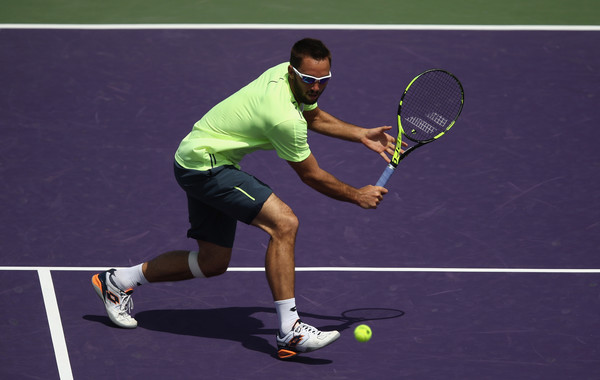 Viktor Troicki prepares for a low backhand during his second round loss. Photo: Julian Finney/Getty Images
