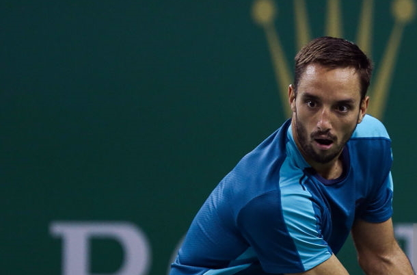 Photo Source: Yifan Ding/Getty Images-Viktor Troicki hitting another backhand winner.