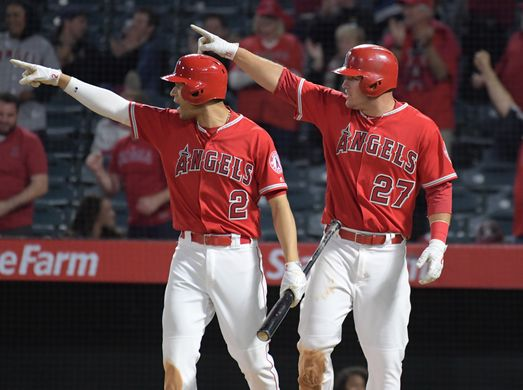 Mike Trout and Andrelton Simmons celebrating game tying run in the ninth inning. | Photo: Kirby Lee/USA TODAY Sports