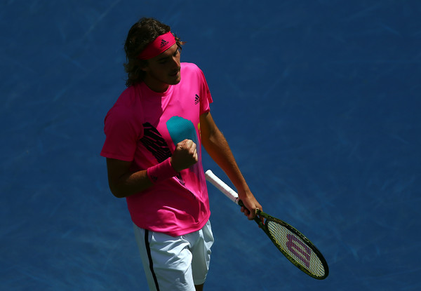 Tsitsipas pumps his fist during his comeback win. Photo: Getty Images