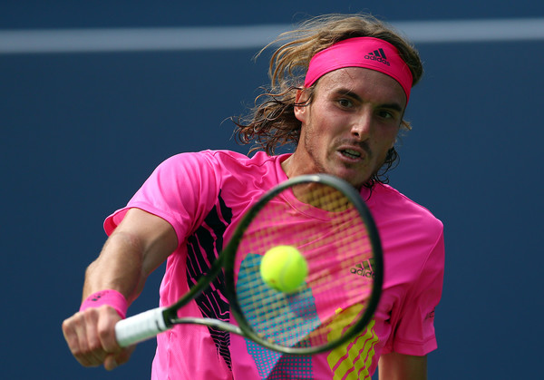 Stefanos Tsitsipas crushes a backhand during his win over Djokovic. Photo: Getty Images