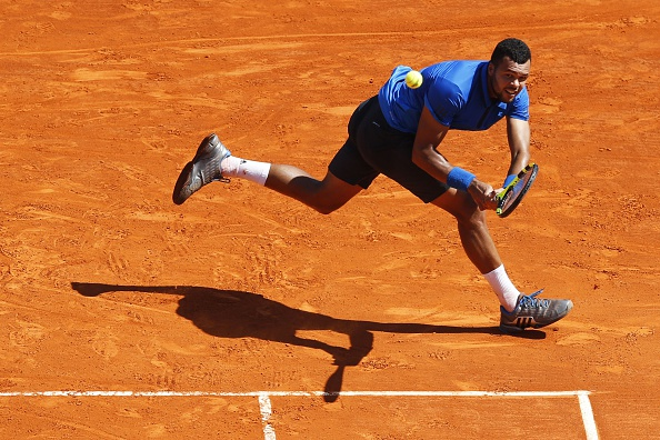 Tsonga sprawls for a backhand during his quarterfinal victory. Photo: Valery Hache/AFP/Getty Images
