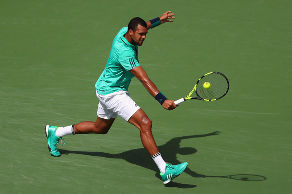 Jo-Wilfried Tsonga plays a backhand during his win on Tuesday. Photo: Julian Finney/Getty Images