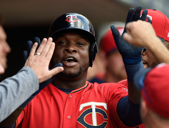 Sano celebrates in the dugout. (Hannah Foslien/Getty Images)
