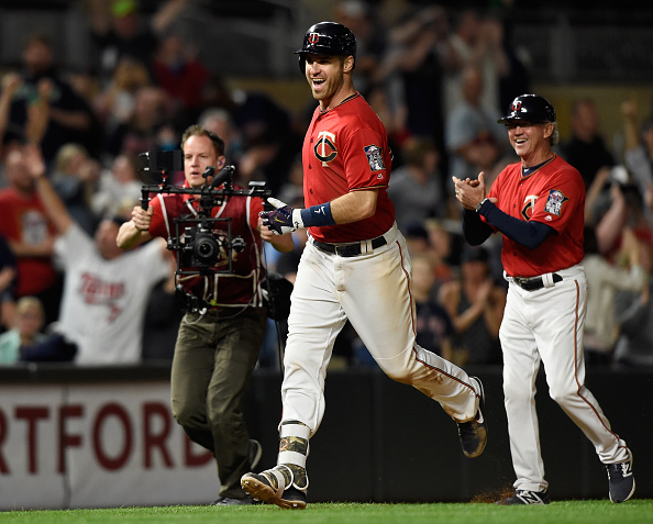 Mauer rounds third after hitting his home run. (Hannah Foslien/Getty Images)