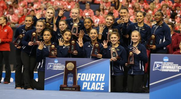 UCLA Gymnastics receives the fourth place trophy. Photo Credit: UCLA Gymnastics Twitter.
