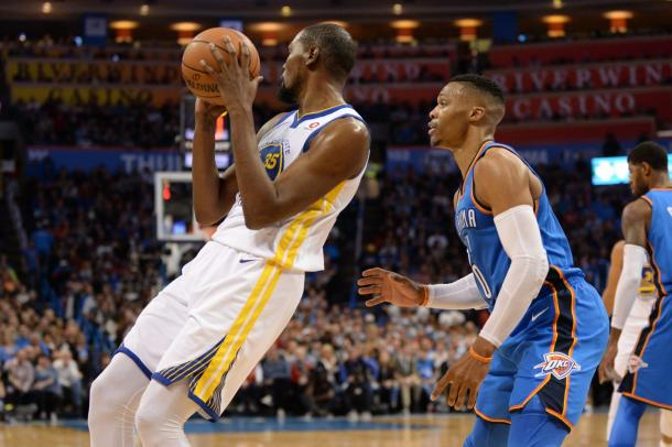 Golden State Warriors forward Kevin Durant (35) controls the ball in front of Oklahoma City Thunder guard Russell Westbrook (0) during the second quarter at Chesapeake Energy Arena. |Mark D. Smith|