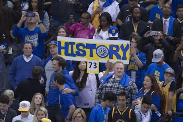 Warriors fans celebrating their team breaking the record for most wins in a regular season. Photo: Kyle Terada/USA Today