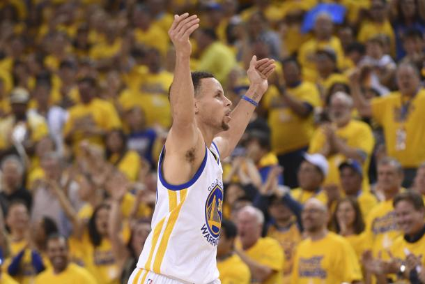 Stephen Curry celebrates after making one of his five threes for the night.
