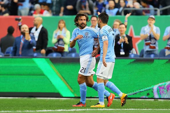 Andrea Pirlo and David Villa celebrate goal against Toronto FC | Mike Stobe - Getty Images Sport