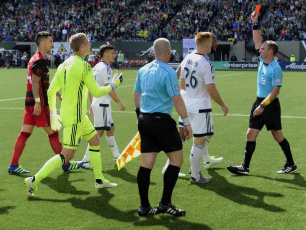 Ted Unkel (far right) hands out a red card during the Portland Timbers and Vancouver Whitecaps match in May of 2016 | Source: Steve Dykes - AP Photo
