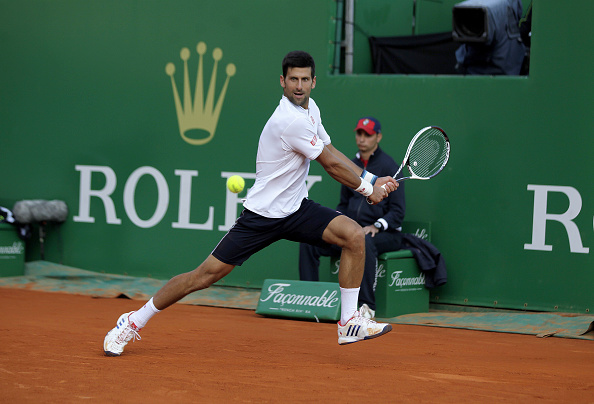 Novak Djokovic goes for a backhand shot (Photo: Laurent Lairys/Getty Images)