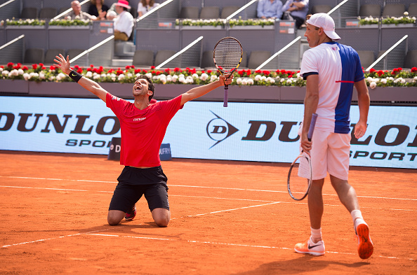 Marcelo Melo and Lukasz Kubot celebrate defeating Nicolas Mahut and Edouard Roger-Vasselin (Photo: Denis Doyle/Getty Images)