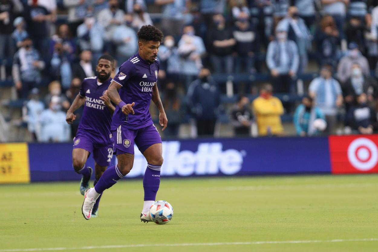 Urso dribbling downfield with lots of back and fourth action in the first half. (Photo credit: Orlando City Twitter)