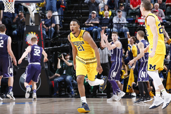 Zak Irvin #21 of the Michigan Wolverines celebrates hitting the game-winning shot against the Northwestern Wildcats.(March 9, 2016 - Source: Joe Robbins/Getty Images North America)