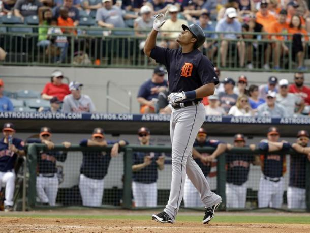 Detroit Tigers' Steven Moya points upward as he runs past the Houston Astros dugout to home plate after hitting a home run. (John Raoux, Associated Press)