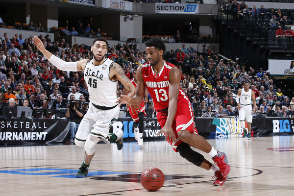 JaQuan Lyle #13 of the Ohio State Buckeyes drives against Denzel Valentine #45 of Michigan State Spartans in the quarterfinal round of the Big Ten Basketball Tournament at Bankers Life Fieldhouse on March 11, 2016 in Indianapolis, Indiana. (March 10, 2016 - Source: Joe Robbins/Getty Images North America)