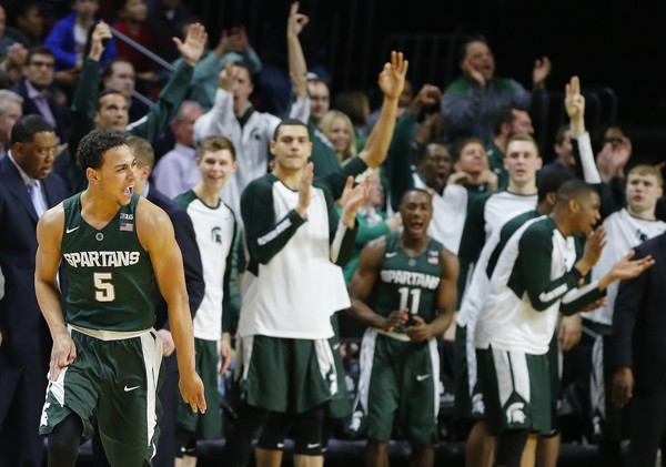 Bryn Forbes #5 of the Michigan State Spartans reacts after scoring a three-point basket as the bench cheers against the Rutgers Scarlet Knights during the second half of a college basketball game at the Rutgers Athletic Center on March 2, 2016 in Piscataway, New Jersey. Michigan State defeated Rutgers 97-66. (March 2, 2016 - Source: Rich Schultz/Getty Images North America)