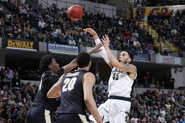 Denzel Valentine #45 of the Michigan State Spartans passes while defended by Caleb Swanigan #50 and A.J. Hammons #20 of the Purdue Boilermakers. Michigan State defeated Purdue 66-62. (March 12, 2016 - Source: Joe Robbins/Getty Images North America)