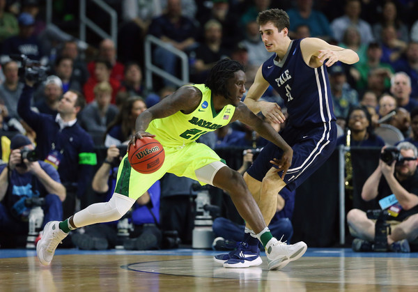 Taurean Prince #21 of the Baylor Bears drives against Nick Victor #21 of the Yale Bulldogs in the first half of their game during the first round of the 2016 NCAA Men's Basketball Tournament at Dunkin' Donuts Center on March 17, 2016 in Providence, Rhode Island. (March 16, 2016 - Source: Jim Rogash/Getty Images North America)
