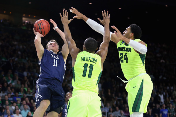Makai Mason #11 of the Yale Bulldogs shoots the ball as he is defended by Lester Medford #11 of the Baylor Bears and Ishmail Wainright #24 in the first half of their game during the first round of the 2016 NCAA Men's Basketball Tournament at Dunkin' Donuts Center on March 17, 2016 in Providence, Rhode Island. (March 16, 2016 - Source: Jim Rogash/Getty Images North America)