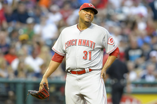 Starting pitcher Alfredo Simon #31 of the Cincinnati Reds reacts after giving up a three-run home run during the fourth inning against the Cleveland Indians at Progressive Field on August 4, 2014 in Cleveland, Ohio. (Aug. 3, 2014 - Source: Jason Miller/Getty Images North America)