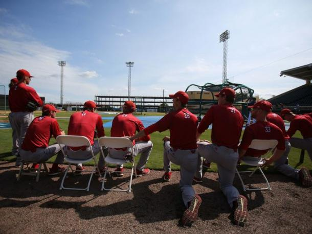 Florida Southern Moccasins players watch the Detroit Tigers practice before their exhibition game. (Kimberly P. Mitchell /  DFP)