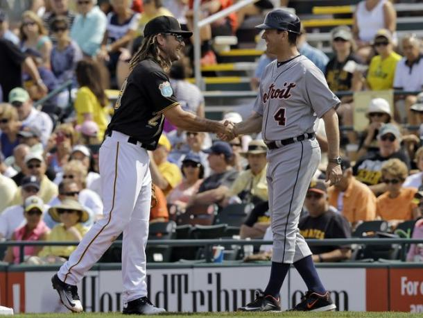 Michigan football coach Jim Harbaugh (4) shakes hands with Pittsburgh Pirates first baseman John Jaso during the first inning of a spring training baseball game between the Pirates and the Detroit Tigers. (Chris O'Meara, Associated Press)