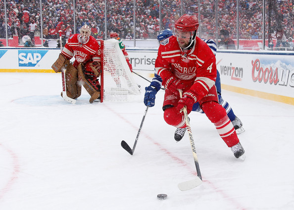 Jakub Kindl #4 of the Detroit Red Wings heads up ice as Nikolai Kulemin #41 of the Toronto Maple Leafs gives chase during the 2014 Bridgestone NHL Winter Classic. (Dec. 31, 2013 - Source: Gregory Shamus/Getty Images North America)