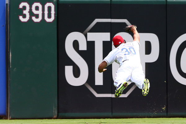 Will Venable #30 of the Texas Rangers makes a diving catch in the second inning during a game against the Toronto Blue Jays. (Aug. 26, 2015 - Source: Sarah Crabill/Getty Images North America)