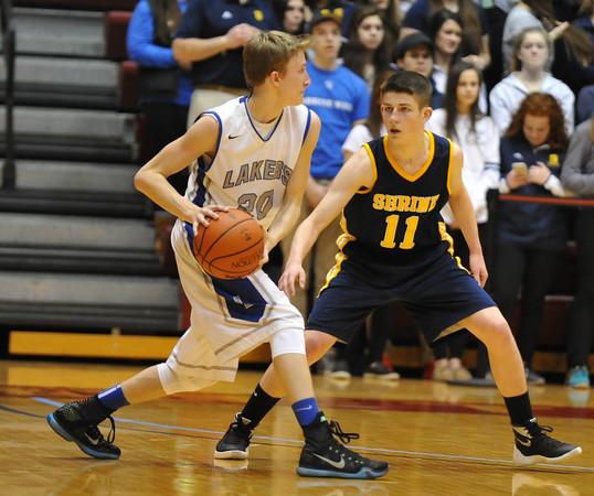 Noah Robak makes a pass with Ian Gappy defending. (Ken Swart / MIPrepZone)