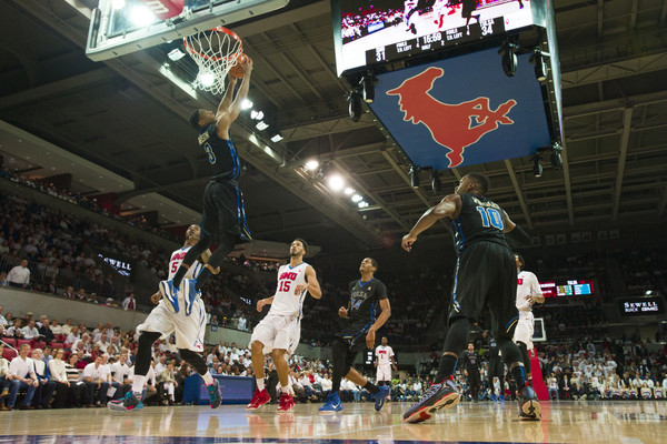Shaquille Harrison #3 of the Tulsa Golden Hurricane dunks the ball against the SMU Mustangs on March 8, 2015 at Moody Coliseum in Dallas, Texas. (March 7, 2015 - Source: Cooper Neill/Getty Images North America)