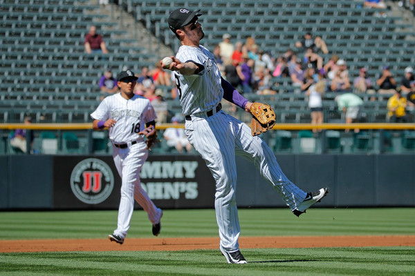 Third baseman Nolan Arenado #28 of the Colorado Rockies fields an infield single by Andrew McCutchen #22 of the Pittsburgh Pirates in the first inning at Coors Field on September 24, 2015 in Denver, Colorado. (Sept. 23, 2015 - Source: Doug Pensinger/Getty Images North America)