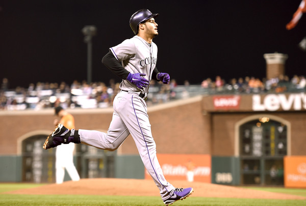 Nolan Arenado #28 of the Colorado Rockies trots around the bases after hitting a solo home run off of Chris Heston #53 of the San Francisco Giants in the top of the second inning at AT&T Park on October 2, 2015 in San Francisco, California. (Oct. 1, 2015 - Source: Thearon W. Henderson/Getty Images North America)