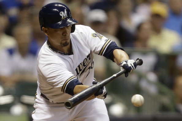 Kyle Lohse #26 of the Milwaukee Brewers lays down a bunt in the third inning against the Atlanta Braves at Miller Park on July 06, 2015 in Milwaukee, Wisconsin. (July 5, 2015 - Source: Mike McGinnis/Getty Images North America)