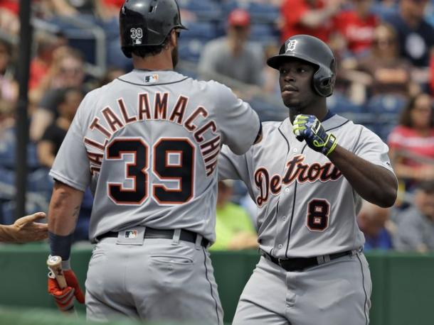 Detroit Tigers' Justin Upton high fives on-deck batter Jarrod Saltalamacchia after hitting a home run off Philadelphia Phillies' James Russell during the first inning of a spring training baseball game Saturday, March 26, 2016, in Clearwater, Fla.  Chris O'Meara, Associated Press