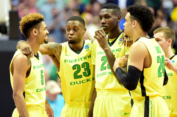 Tyler Dorsey #5, Elgin Cook #23, Chris Boucher #25, Casey Benson #2 and Dillon Brooks #24 of the Oregon Ducks huddle while taking on the Oklahoma Sooners in the NCAA Men's Basketball Tournament West Regional Final at Honda Center on March 26, 2016 in Anaheim, California. (March 25, 2016 - Source: Harry How/Getty Images North America)