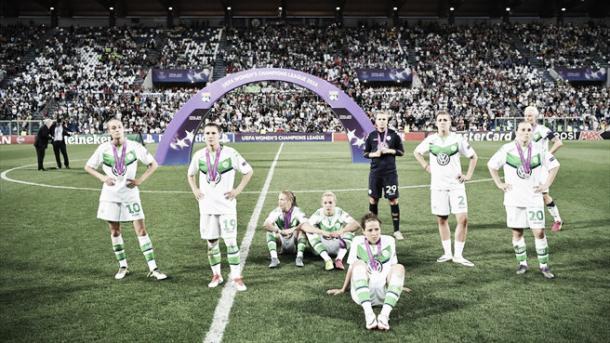 Wolfsburg watch on as Lyon lift the title. (Photo: UEFA)