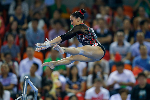 Vanessa Ferrari performs on the uneven bars at the 2014 World Artistic Gymnastics Championships in Nanning/Getty Images